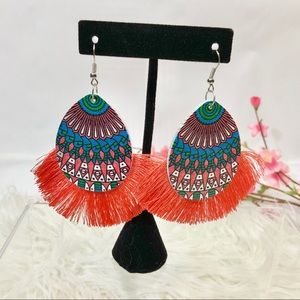 Bright earrings with fringe